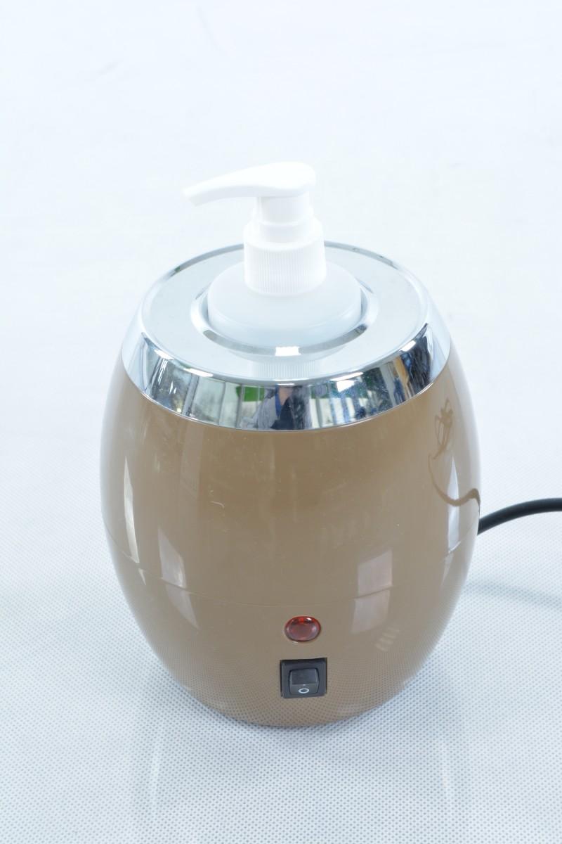 Masažo aliejus šildytuvas komplektuojamas su butelio